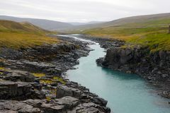 Small Stream and cliffs in Iceland. Small Stream and cliffs somewhere in Iceland stock photos