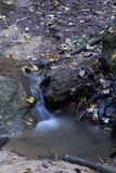 Small stream detail, Conkles Hollow Nature Preserve. A small waterfall is formed by a creek in the bottom of the gorge in Conkle`s Hollow Nature Preserve at royalty free stock photos