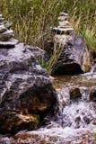 Small stream. Gray stones. Paganism. Vera. Green grass. Small stream. Big gray stones. Green grass. Beautiful view. Water Stock Photo