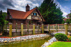 Small stream and red-roofed building in Helen, Georgia. Royalty Free Stock Image