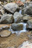 Small stream and rocks. At spring forest Royalty Free Stock Images