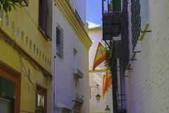 A small street in Andalusia with the flags of Spain. royalty free stock photos