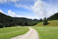 Small street in the bavarian alps Royalty Free Stock Images