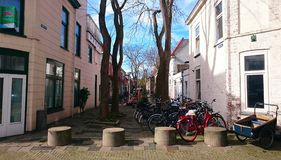 Small street with bycicles parked. Royalty Free Stock Photos