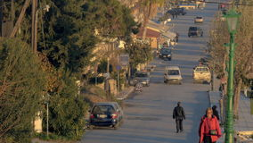 Small street with few cars and people, Greece stock footage