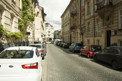 A small street lined with cars. In the city of Lviv Royalty Free Stock Photos