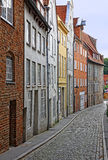 Small street with old buildings in Lubeck Royalty Free Stock Photo