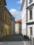 Small street with paving and old buildings Royalty Free Stock Images