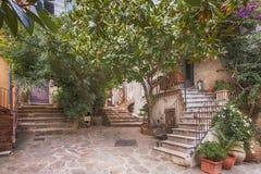 Small street at Saint Tropez, France. Saint Tropez, France - September 5, 2016: Small street at Saint Tropez, France Royalty Free Stock Photos