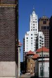 Small street and skyscraper Stock Image