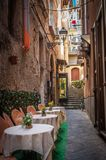 Small street at Sorrento. Lovely, narrow street at Sorrento with tables Royalty Free Stock Image