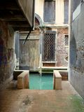 Small street in Venezia with access to the canal royalty free stock images