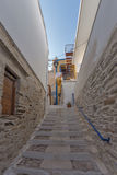 Small street and white houses in old town of Ermopoli, Syros, Greece Royalty Free Stock Images