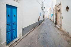 Small street and wooden door Stock Photography