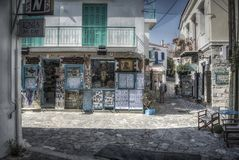 Small Streets of Skiathos. Skiathos, Greece – June 26th 2015: Streets of Skiathos, full of local shops and products, typical Greek scenery Royalty Free Stock Photos
