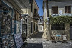 Small Streets of Skiathos. Skiathos, Greece – June 26th 2015: Streets of Skiathos, full of local shops and products, typical Greek scenery Royalty Free Stock Image