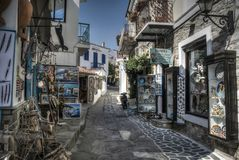 Small Streets of Skiathos. Skiathos, Greece – June 26th 2015: Streets of Skiathos, full of local shops and products, typical Greek scenery Royalty Free Stock Photo
