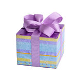 A small stripped gift box with a purple bow. Royalty Free Stock Photography