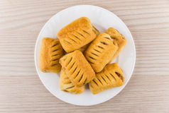 Small strudels in glass plate on table Stock Photography