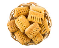 Small strudels in wicker basket Royalty Free Stock Photo