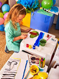 Small student child painting in art school class. Royalty Free Stock Image