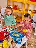 Small students children painting in art school class. Royalty Free Stock Photos