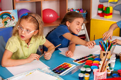Small students children painting in art school class. Royalty Free Stock Images