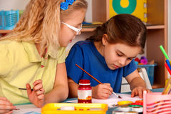 Small students children painting in art school class. Royalty Free Stock Photography