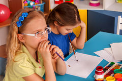 Small students children painting in art school class. Royalty Free Stock Photo