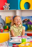 Small students children painting in art school class. Stock Image