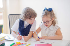 Small students diligently do a homework. Stock Photography