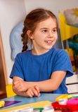 Small students girl painting in art school class. stock images