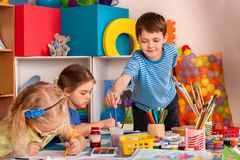 Small students girl painting in art school class. royalty free stock photo