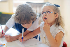 Small students at a lesson. Stock Photography