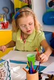 Small students children painting in art school class. Small students painting in art school class. Child drawing by paints on table. Kid on balloons background royalty free stock images
