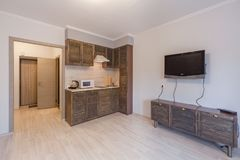Small studio apartment and kitchen hightech interior Royalty Free Stock Photos