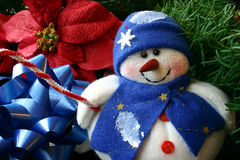 Small Stuffed Snowman. This is a small stuffed snowman surrounded by christmas decorations Stock Photo