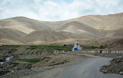A small stupa located on mountain road in Leh, India Stock Image