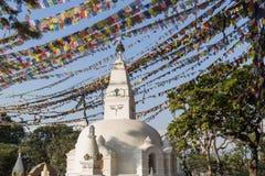 Small stupa with prayer flags at Swayambunath temple, Kathmandu, Nepal Royalty Free Stock Photos
