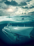Small submarine supervises the sea. The submarine on periscope depth Royalty Free Stock Image