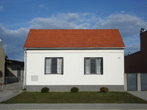 Small suburban house with small grass area Royalty Free Stock Photography