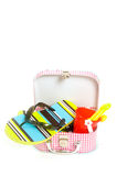 Small suitcase with sand toys and slippers Royalty Free Stock Photography