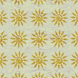 Small sun patterns on beige liquid surface Royalty Free Stock Images