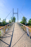 Small suspension bridge leading to a small village, Mekong Delta Royalty Free Stock Photos