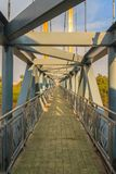 Small suspension steel bridge structure detail. Steel structure Stock Image