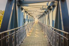 Small suspension steel bridge structure detail. Steel structure Royalty Free Stock Images