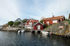 Small swedish boathouse for living close to the sea stock images