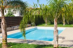Small swimming pool with clean, blue water in the yard of a private house stock images