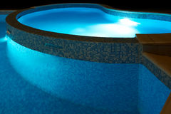 Small swimming pool at night Royalty Free Stock Photos