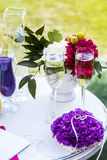 Small table with greeting album and wedding rings Stock Photos